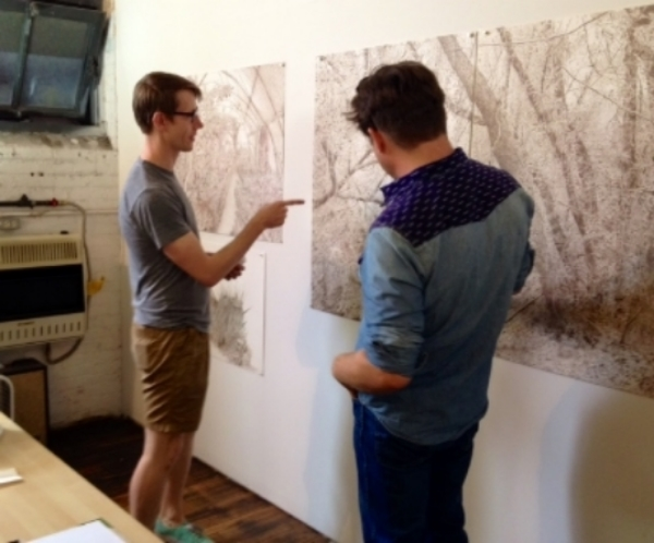 Joey Parlett talking to Quinn Corey about his drawings during Bushwick Open Studios.