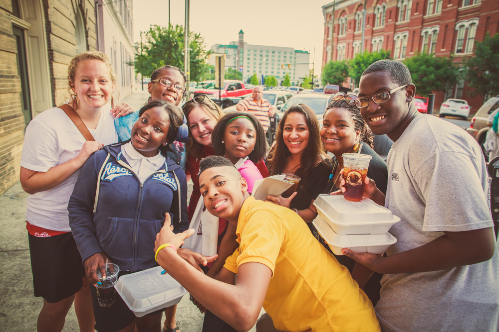 Interns, staff, and high school students in the program head downtown to eat bbq at dreamland.