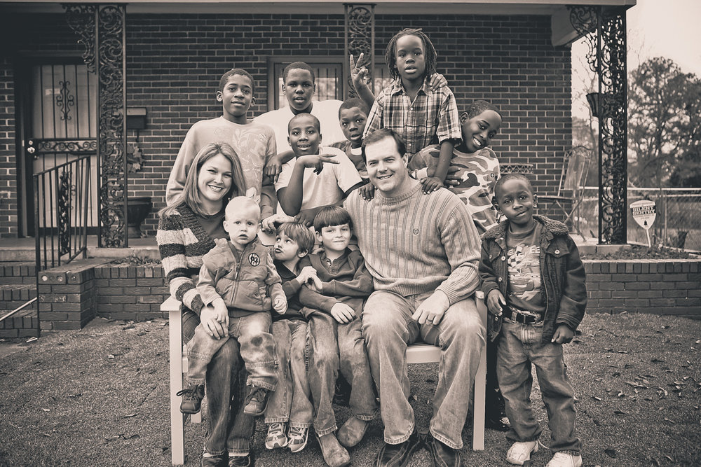 Bryan and Delta Kelly with their family and students from the neighborhood. (Photo courtesy of Wes Roberts Photography)
