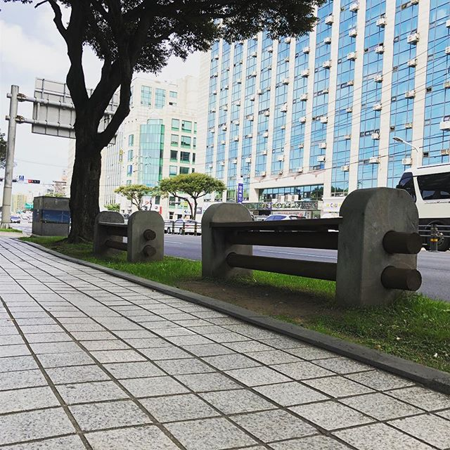 The design of Jeju city benches are derived from their folk village gates where poles are simply inserted into posts mainly to prevent farm animals from getting out. • • • • • • • • #jejuisland #citybench #benchdesign #publicseating #design #designstory #designstudio #industrialdesign #productdesign #furniture #furnituredesign #seatingdesign