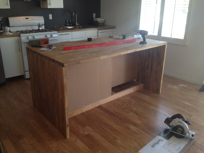 The top is, you guessed, a full sheet of the IKEA wood countertop. This is so heavy, we barely had to fasten it in place much, we just used two brackets on either end, tucked away inside so you can't see them.