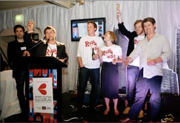 The Raise the Bar crew accepts a SMAC award
