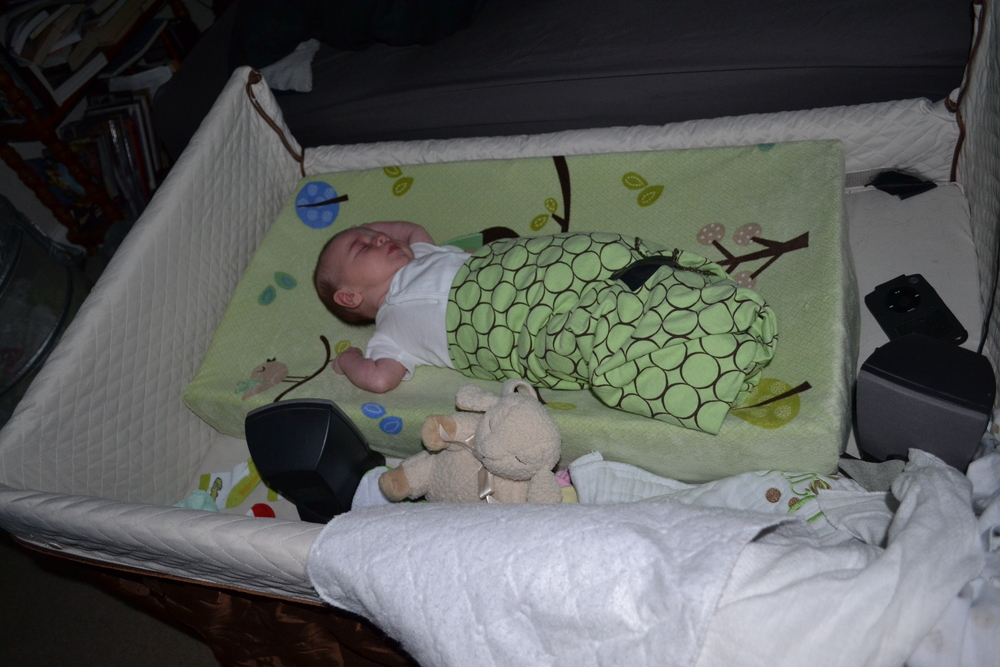 Baby Houdini scoots out of a swaddling blanket, Sleep Sheep makes a cameo appearance