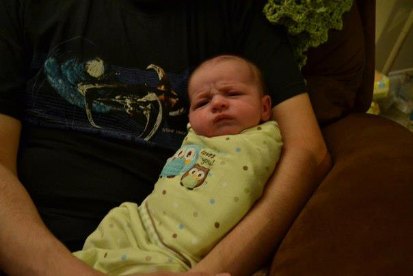 scowling baby says make with the rocking
