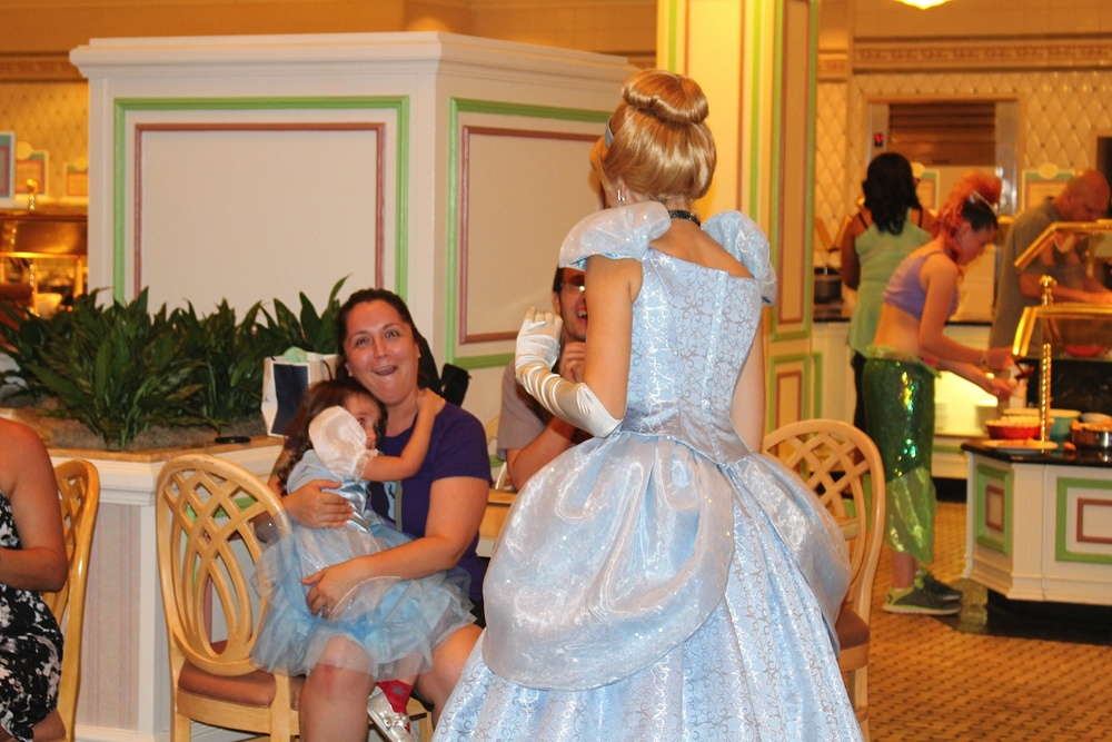 Bella's mom got a great shot of the confusion on my face while D refused to talk to Cinderella