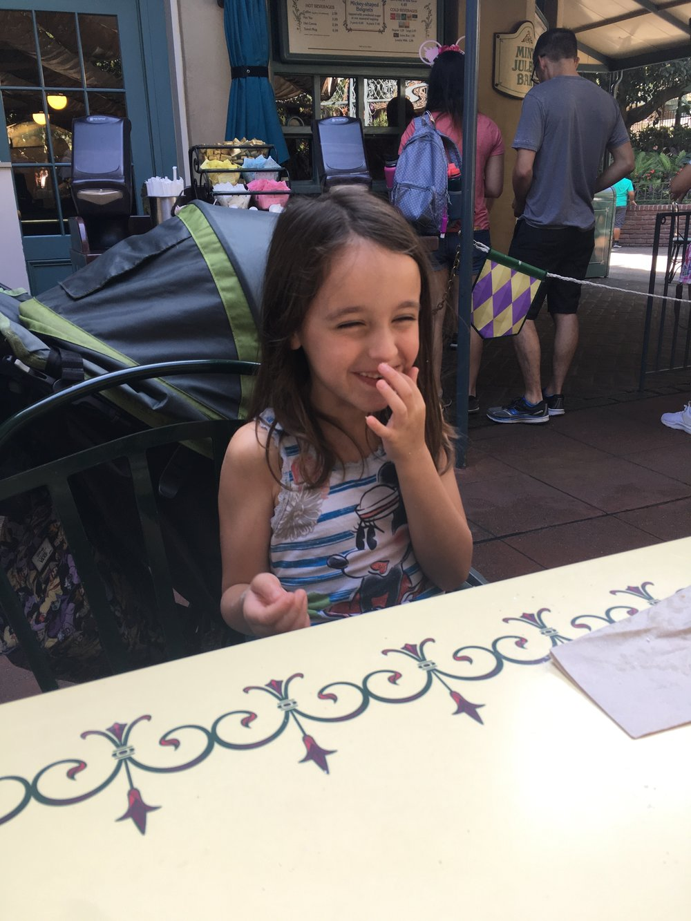 eating beignets and sipping Mint Juleps in New Orleans Square