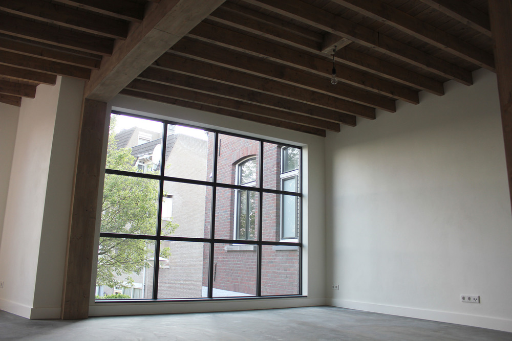 Woonkamer van het bovenste appartement