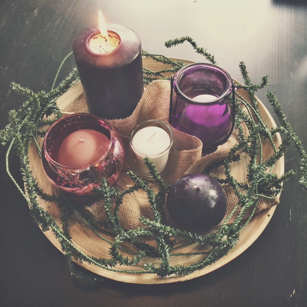 An Advent wreath I put together for our community this year––one of my favorite symbols of the season, layered with meaning. In the shape of a circle to symbolize the eternal nature of God, in Whom there is no beginning nor end. Green to symbolize everlasting life and the exhaustless mercy of God. 3 purple candles that mark the weeks of fasting, mourning, waiting, longing. The 1 pink candle that marks our shift to rejoicing and celebrating the birth of the incarnate God. And finally, the 1 white candle in the center, the Christ candle, symbolizing the perfection and completion that is embodied in Jesus.