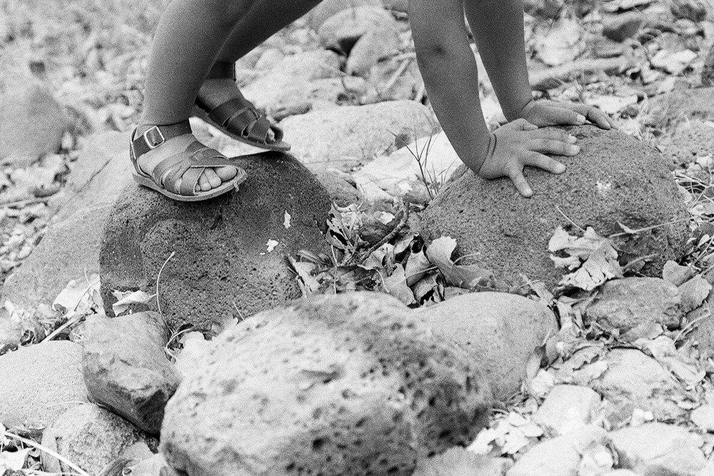 Vivian Climbs Dry River Rocks