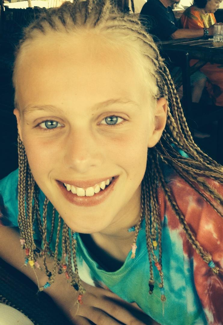 Zoe with her hair braided into corn rows in Zanzibar.