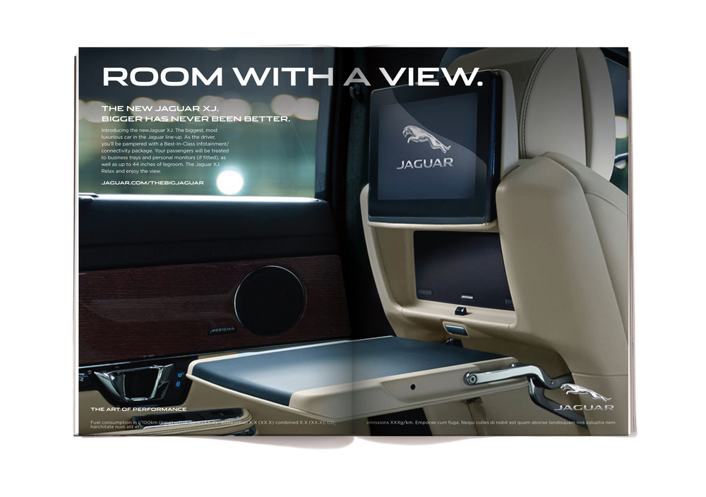 The body copy reads:  Introducing the new Jaguar XJ. The biggest, most luxurious car in the Jaguar line-up. As the driver, you'll be pampered with a Best-In-Class infotainment/connectivity package. Your passengers will be treated to business trays and personal monitors (if fitted), as well as up to 44 inches of legroom. The Jaguar XJ. Relax and enjoy the view.