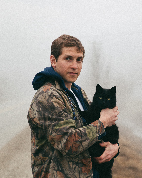 Joel Loughead and Sully the black cat on a foggy day in the beaver valley