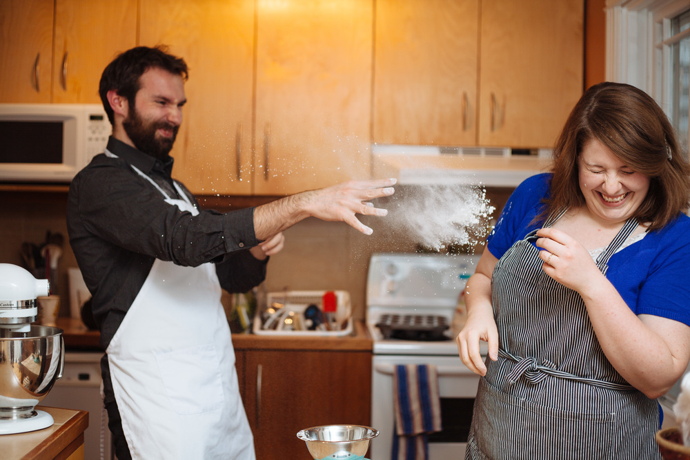 Playful baking engagement session inside the couple's kitchen