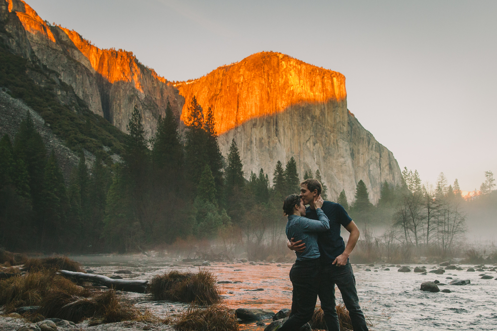 Two people kissing in front of El Capitan during golden hour in Yosemite National Park