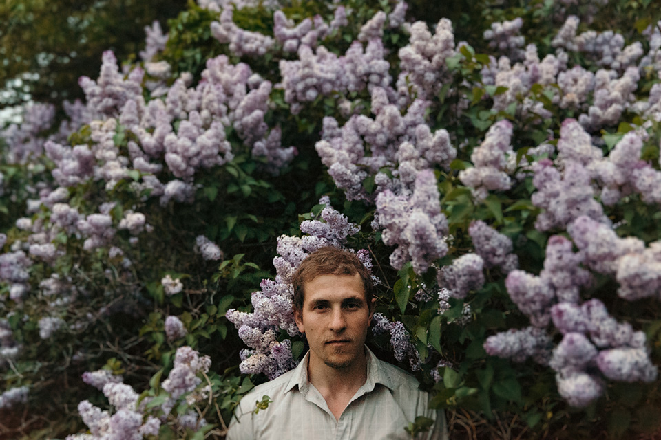 Handsome man in a lilac bush at twilight in the beaver valley, ontario
