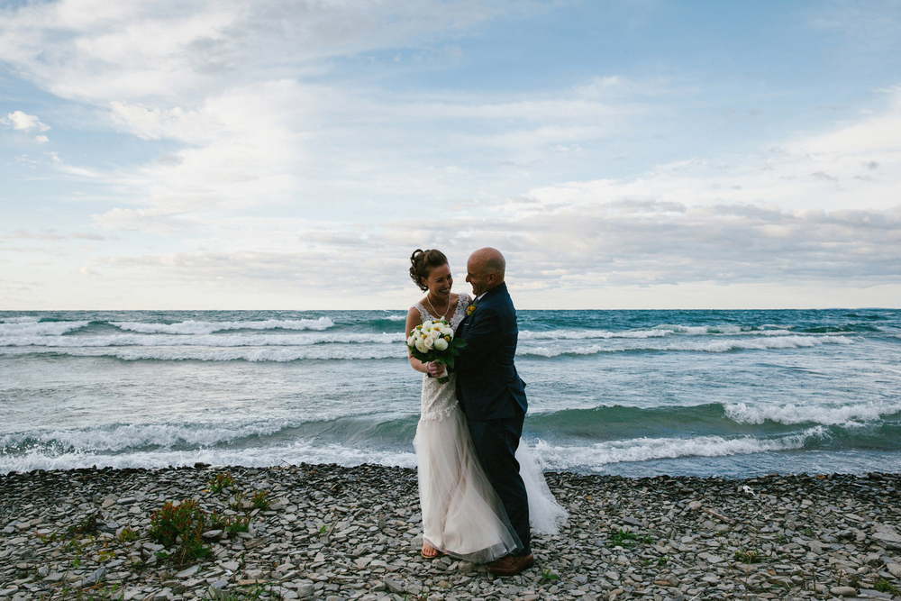 Bride and groom portraits on the beach of Georgian Bay