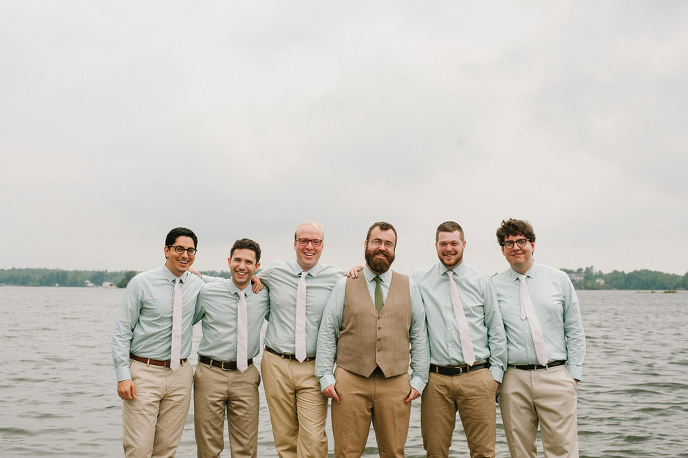 groomsmen portrait on the dock at muskoka camp wedding