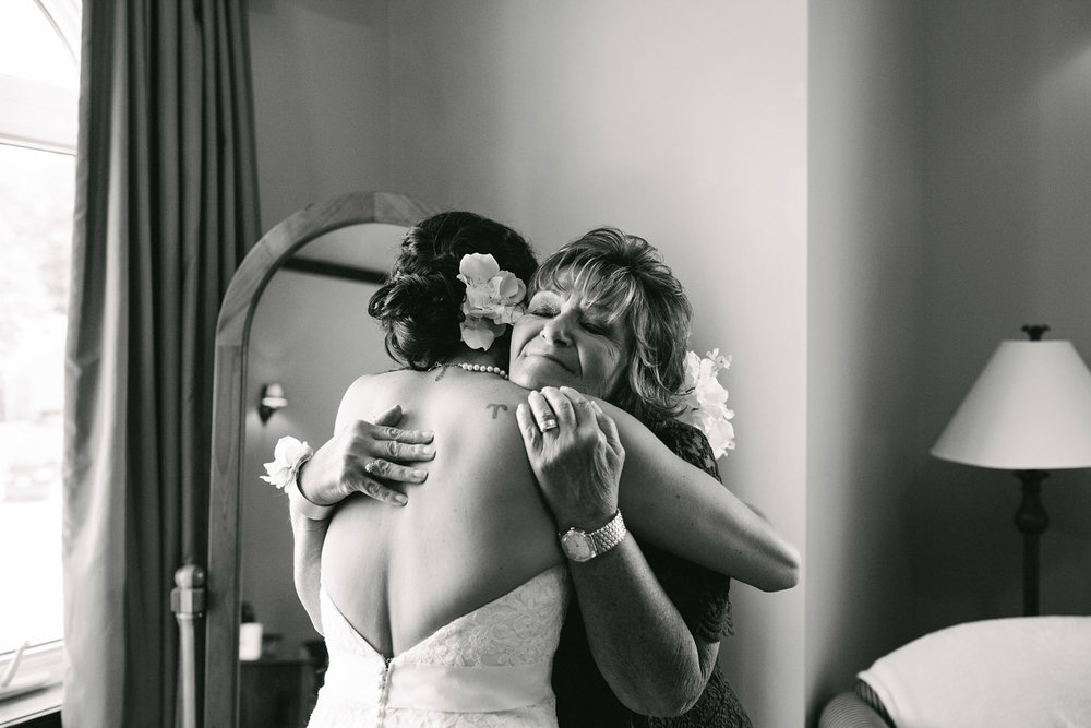 Mother of Bride hugs her daughter