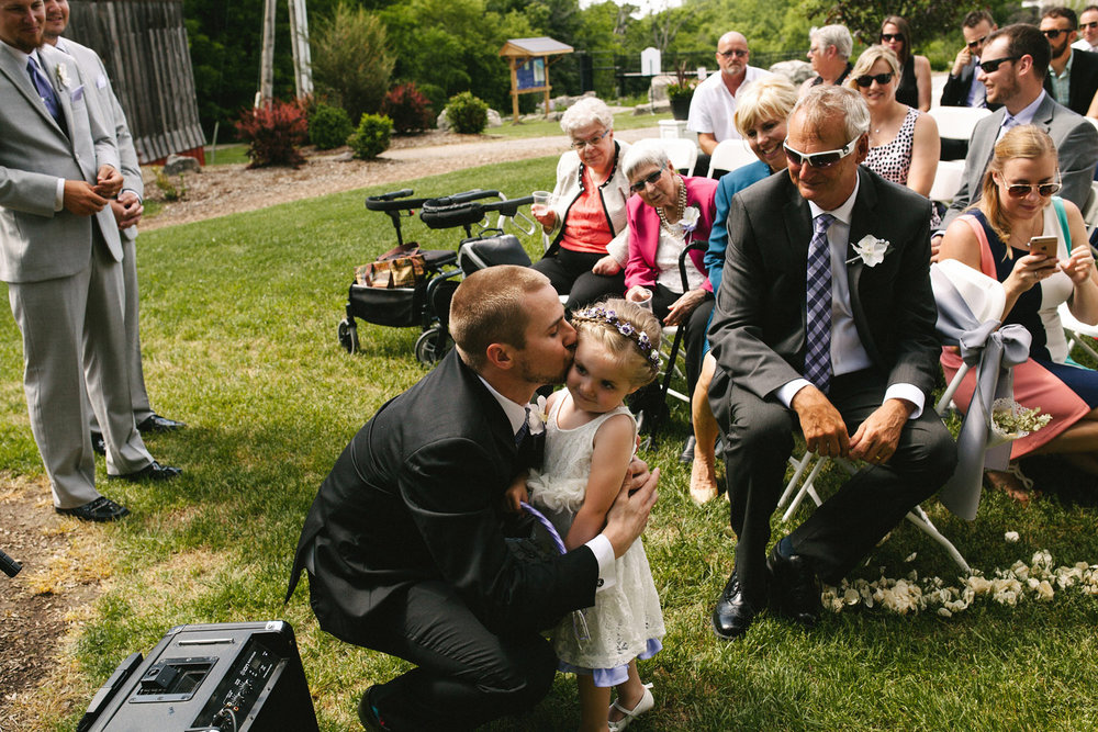 Father hugs his daughter the flower girl