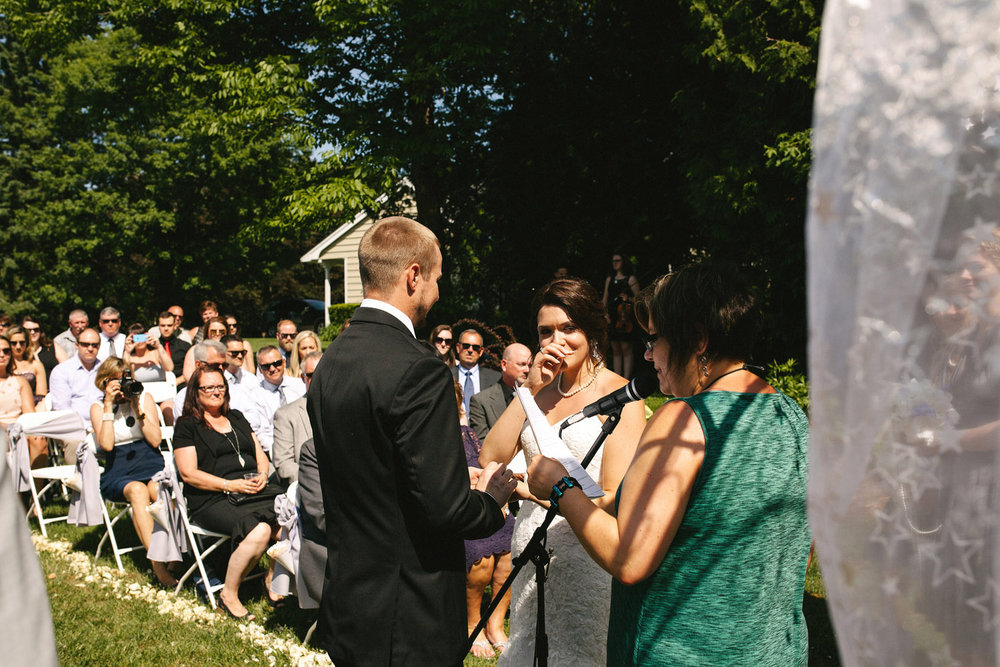 Bride gets emotional at outdoor ceremony