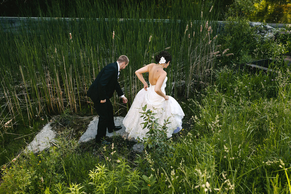 Bride and Groom walk through reeds