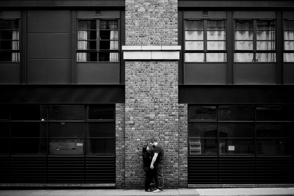 Couple near a historical building during London engagement session
