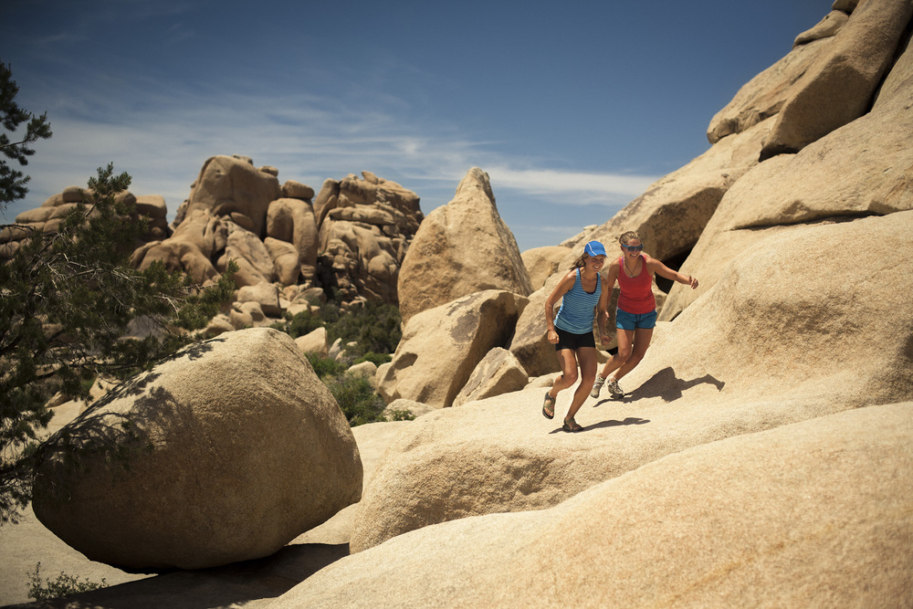 Anna & Katy hopping around Joshua Tree National Park.