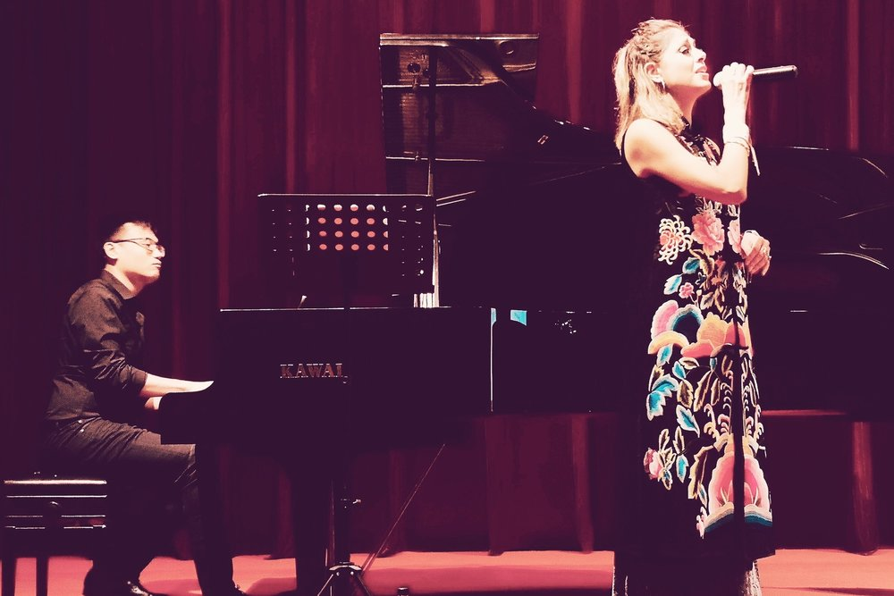 performing with Joshua Cerdenia at the Hangzhou Library in China, in a concert organized by the Shanghai U.S. Consulate