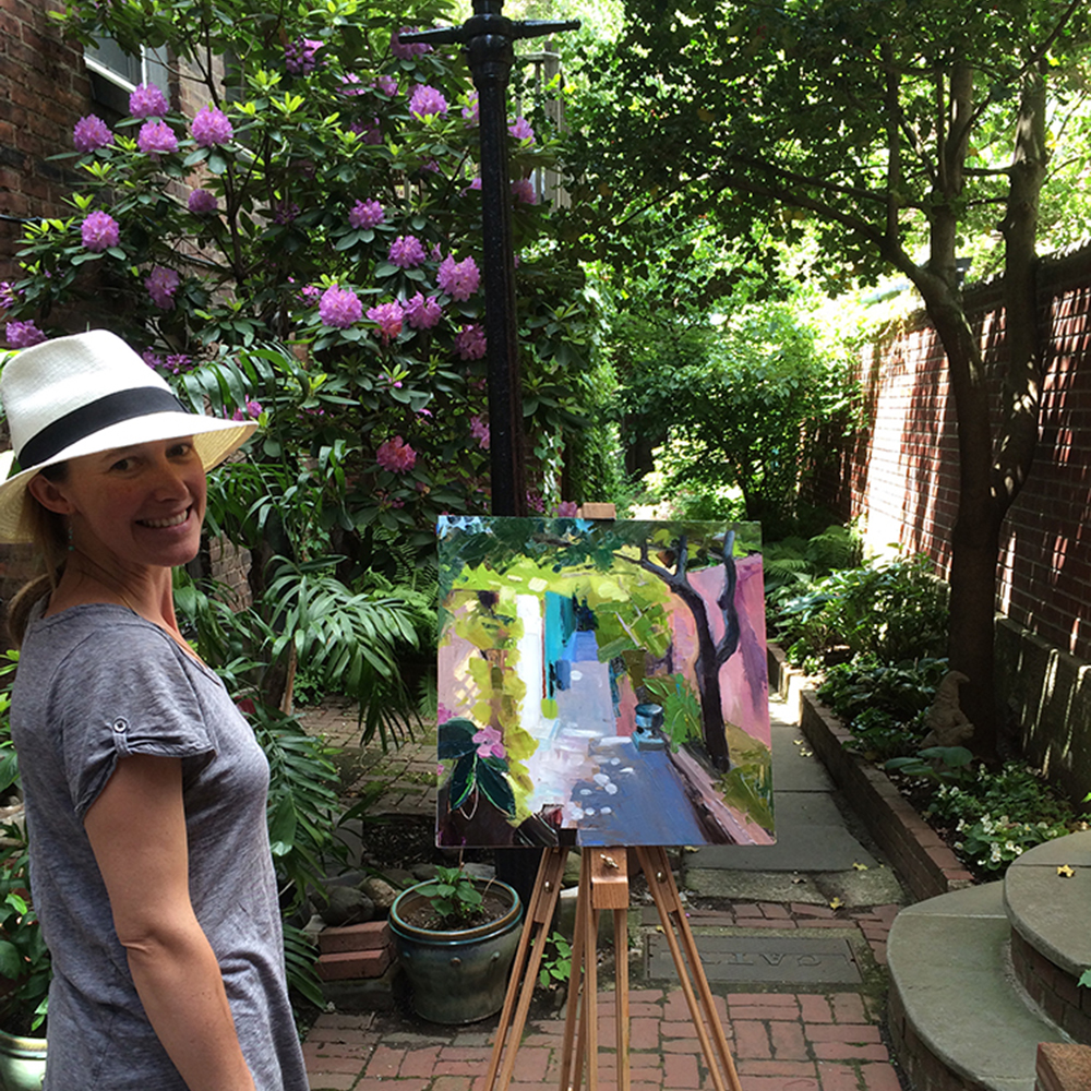 Margaret Langford Sweet stands with her painting on the beautiful Lindall Court