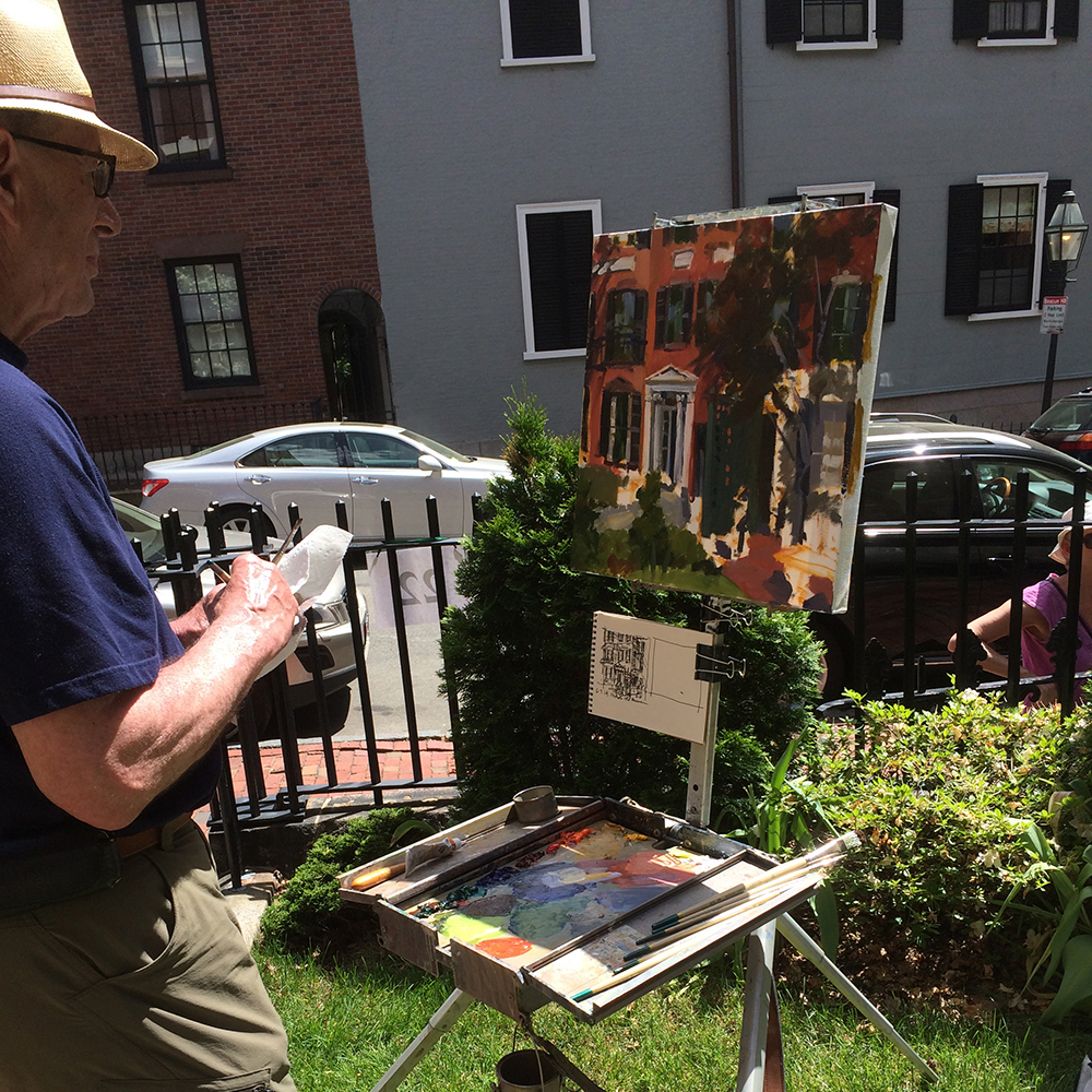 Vcevy Strekalovsky puts the finishing touches on his painting at the Nichols House
