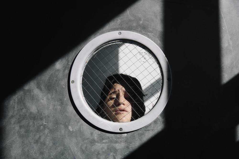 Joey looking through a tiny window