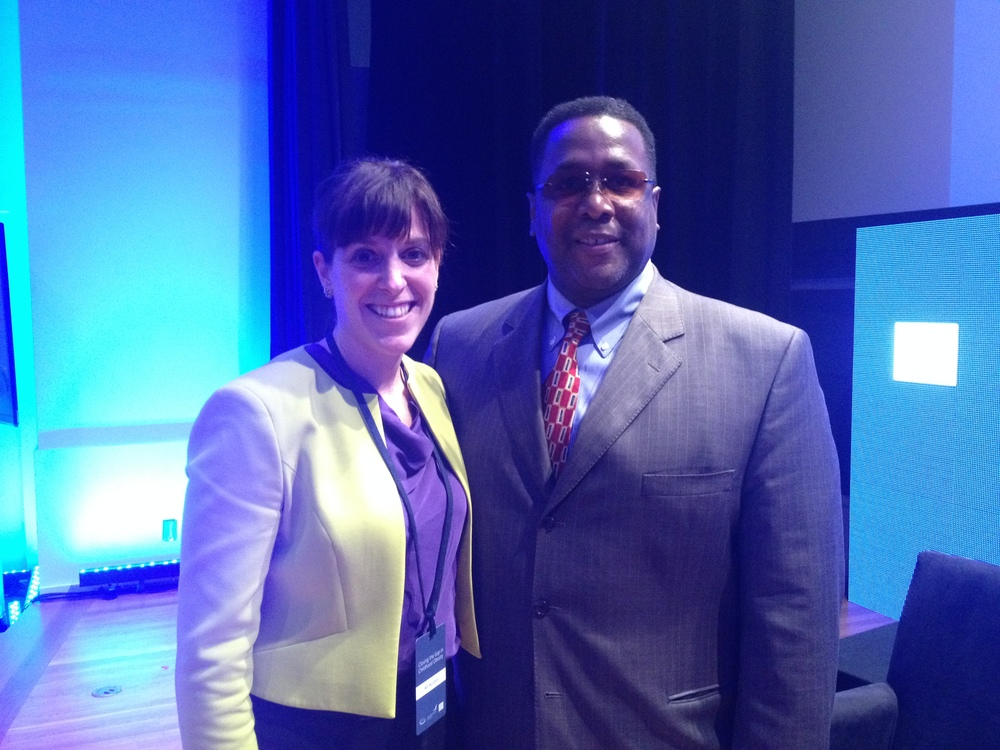 Jess standing with Wendell Pierce, Actor and President of Sterling Farms- working to bring healthy foods to food deserts within New Orleans.