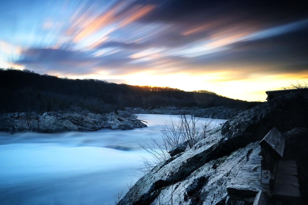 EXIF: ISO 200, f11, 120 seconds @ 18mm. Filters: Big stopper + .9 ND Hard Grad for sky. Dawn, extremely high and fast moving water.