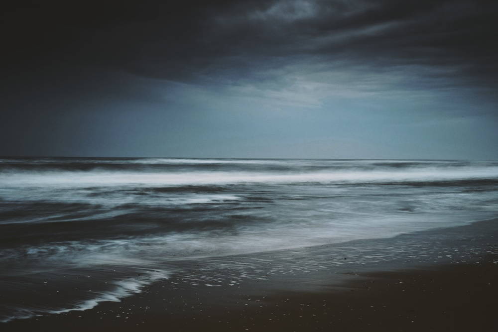 EXIF: ISO 200, f11, 6.5 seconds @ 35mm. Filters: Big Stopper + .45 Hard ND Grad on sky. Windy & gloomy afternoon on the ocean.