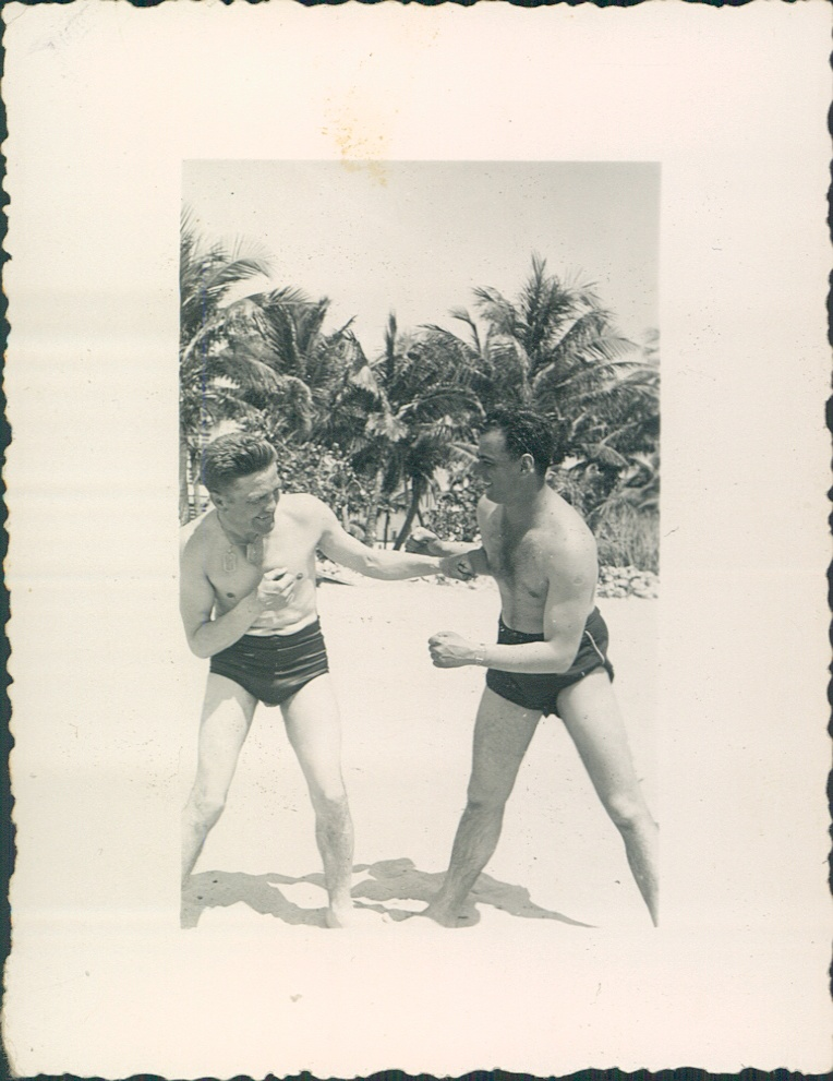 May 1942 Miami Beach My grandfather, Ernest Carbone [right] sparring with Pete Sanstol[left], prize fighter.