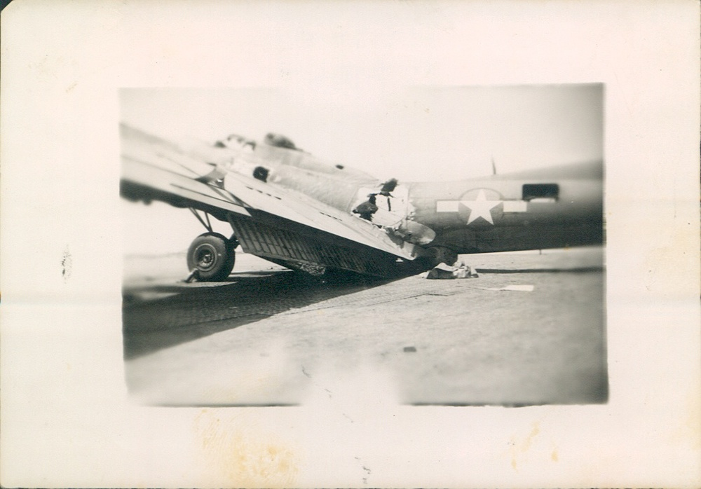 "B-17 Bomber, 99th Army Air Base Wing. ""This one had a rough trip"" - E. Carbone"