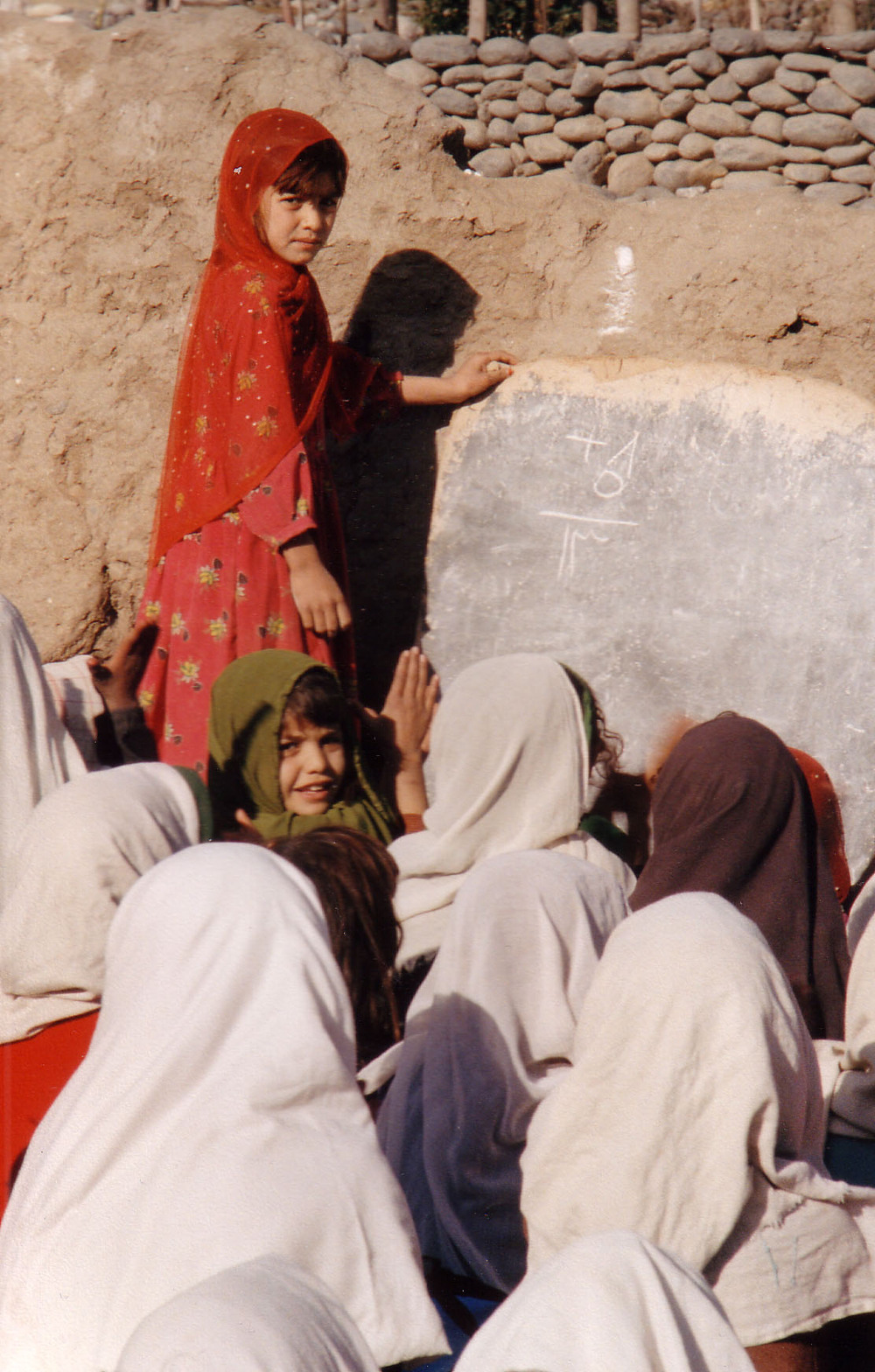Girls learn arithmetic in Afghanistan
