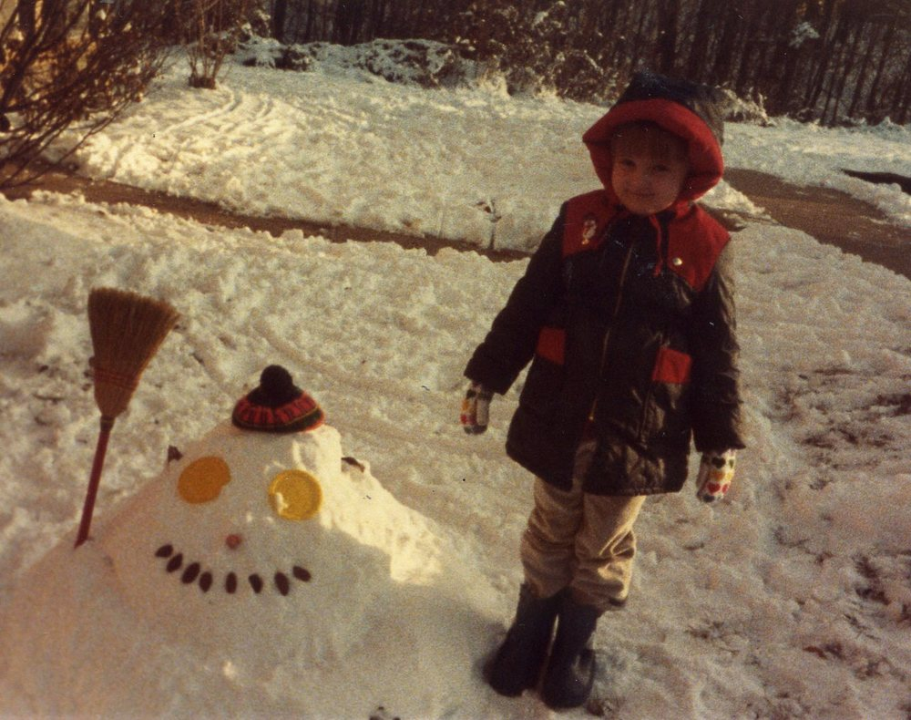 This is a photo of kid Ali, with the world's worst snowman.