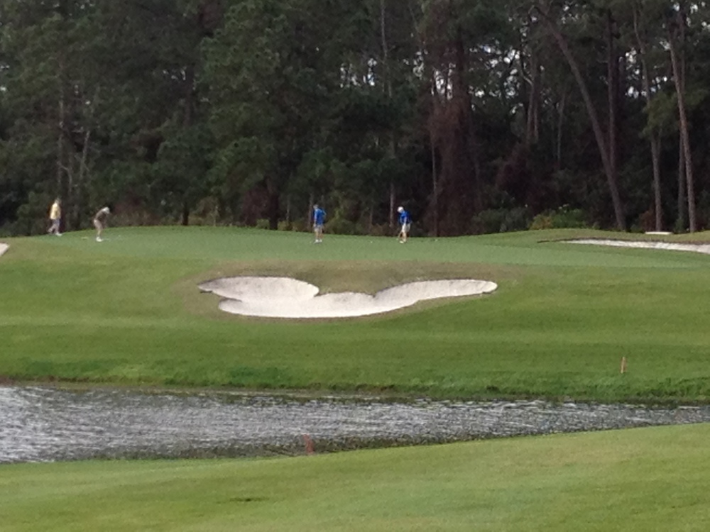 The sand trap in the shape of Mickey Mouse