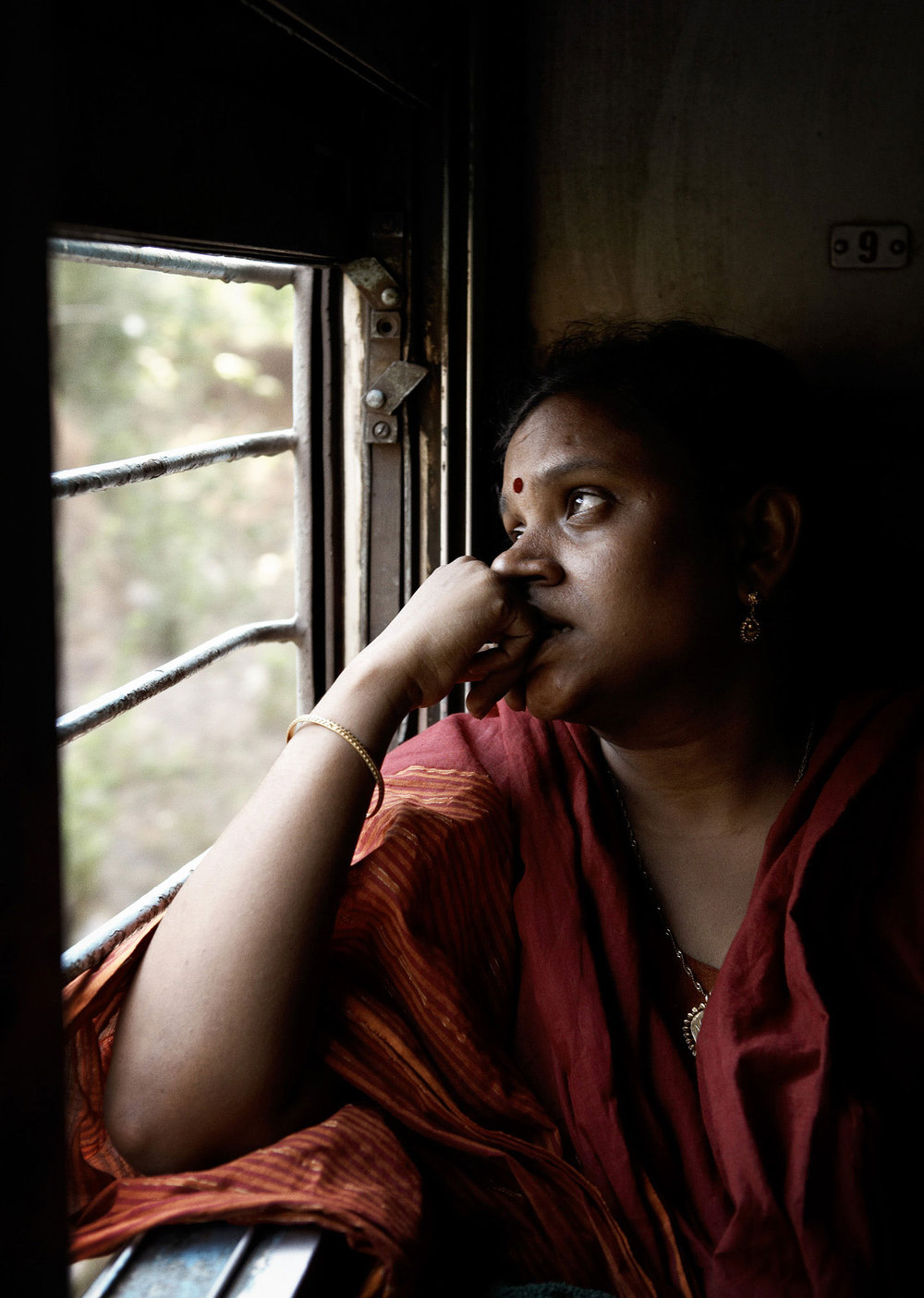 Woman on the train to Kerala, India.