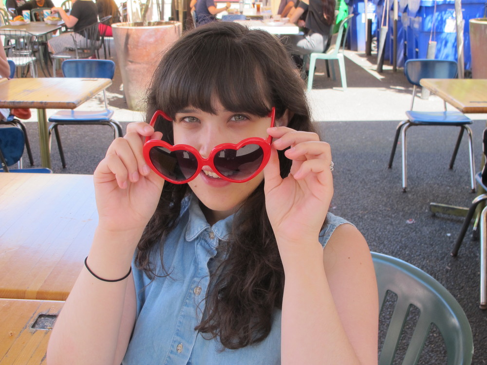 """This is actually a bit different for me,"" Hannah says of her heart-shades she scored at Buffalo Exchanged. She says she usually looks to style icons of the 60s like Brigitte Bardot and Francois Hardy."
