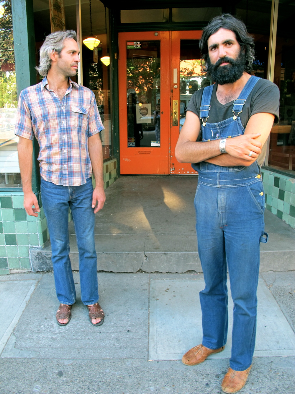 Visiting from California, these two dawn a look that is almost Eurpoean. A man in overalls? Any day.