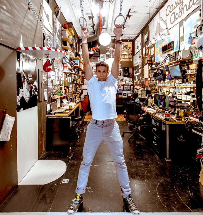 Neistat hangs above a plywood false floor that sits 21 inches above the real one, creating a handy space for stowing gear. Essential items like tripods are kept up front under a hatch.  (Photos: François Dischinger)