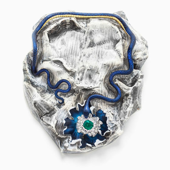 Lunae Lumen Satine Mummy Blue, 2013, Y  ellow and white gold, platinum, emerald, diamonds, colored lacquer, 2   3/4 x 6 5/16 x 8 11/16″
