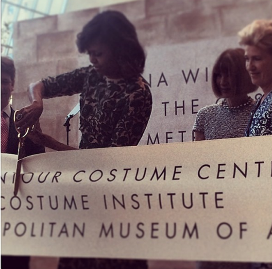 Michelle Obama cutting the ribbon on The Anna Wintour Costume Center, May 6, 2014