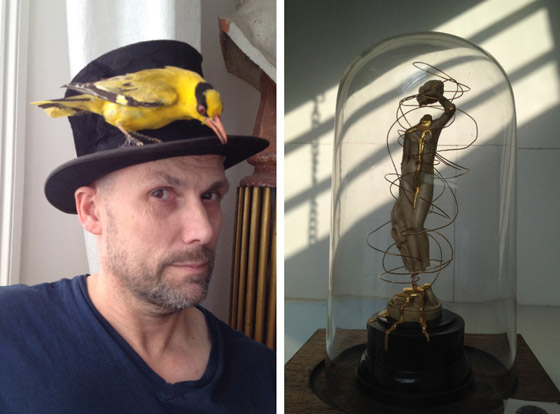 Bouke de Vries, in a hat he was trying on for a friend's fancy-dress birthday party; one of his artworks in his London studio