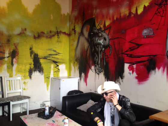 Rob backstage at Brixton Jamm, with a mural painted by a Banksy associate