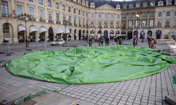 UPDATE: According to The Guardian the cables supporting the the sculpture were cut today, leaving the artwork slumped on the pavement and forcing a security guard to deflate it. FIAC said it intended to resurrect the sculpture as soon as possible.