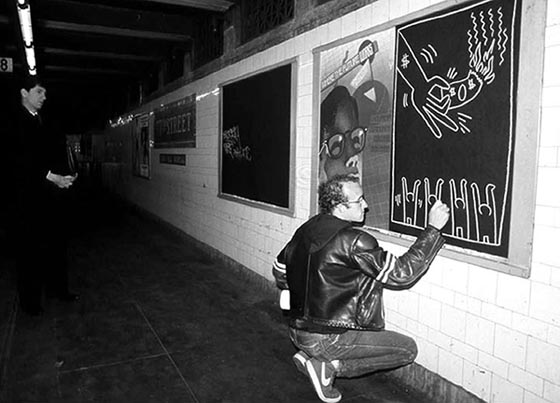 Keith doing a subway drawing, circa '81. Photo by Tseng Kwong Chi