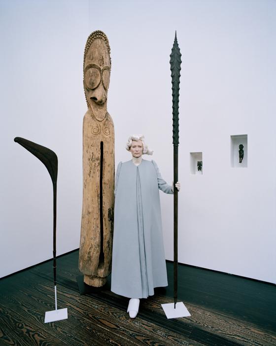 Swinton, among 19th-century Oceanic works, wears Delpozo cape coat